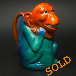 Amusing 1930's polychrome ceramic monkey jug